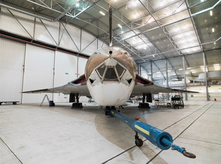 a photo of a large jet plane in a hangar