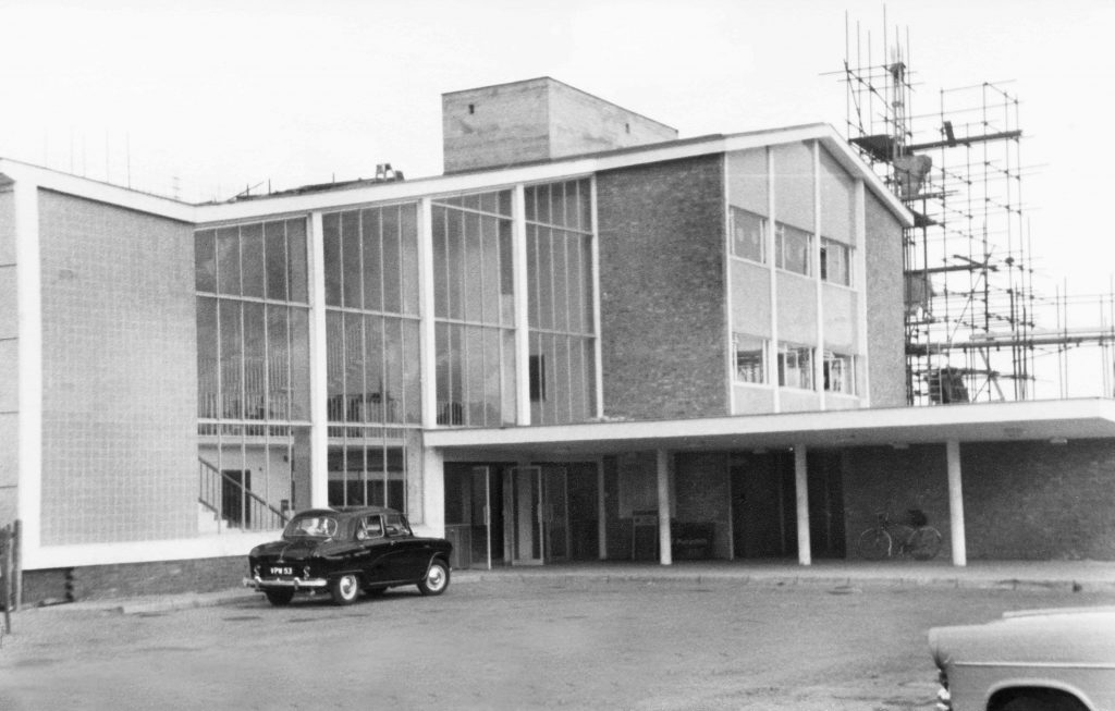 a photo of a building with a high glass 1960s frontage
