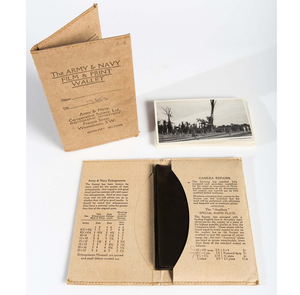 a photo of a small printed catalogue, photo negative wallet and selection of photographs