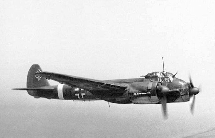 a black and white photo of a German Ju 88 bomber in flight