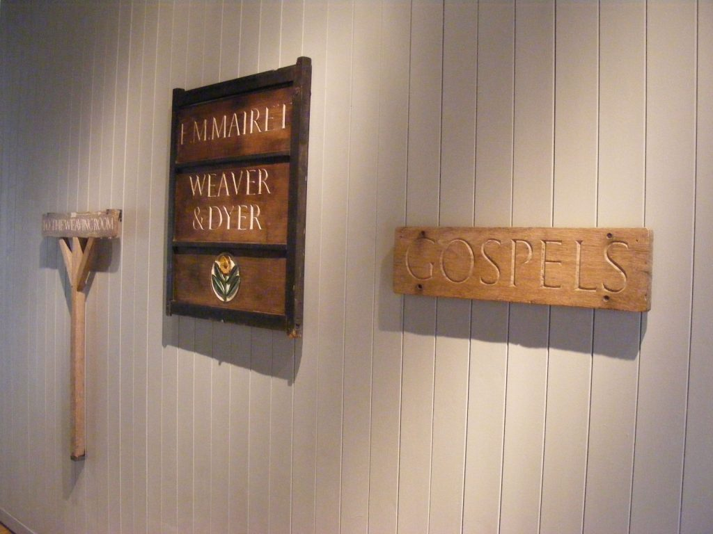 a photo of signage attached to a wood panelled wall