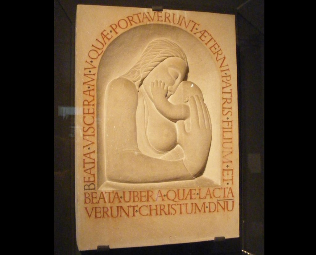 a carved relief panel with a Madonna and Child