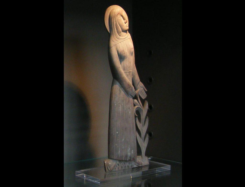 a stone carved female figure