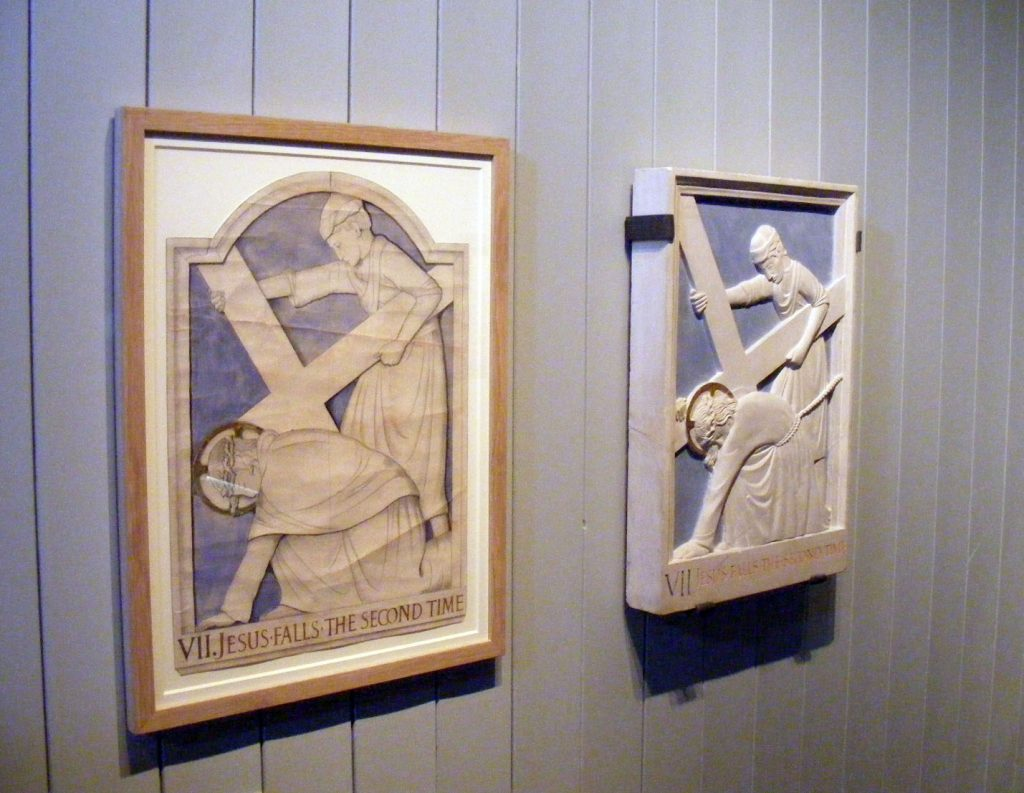 a photo of two relief panels showing Christ's march to the cross