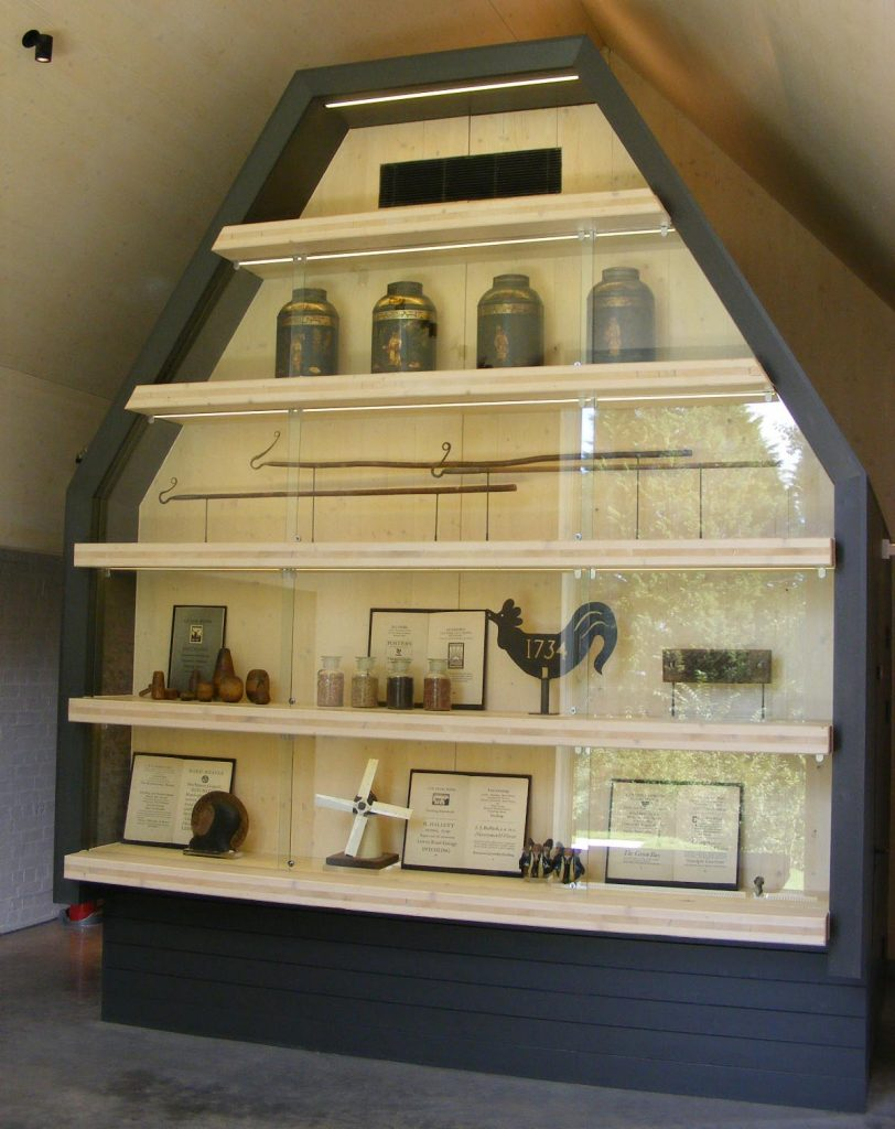 a photo of glass display case shaped like a barn
