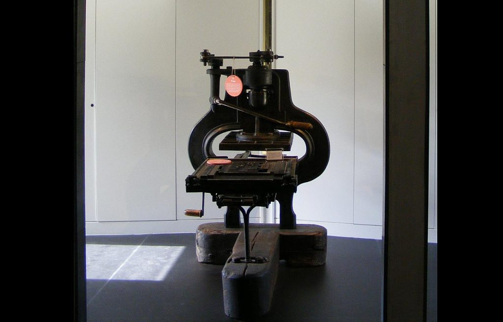 a photo of a printing press in a gallery