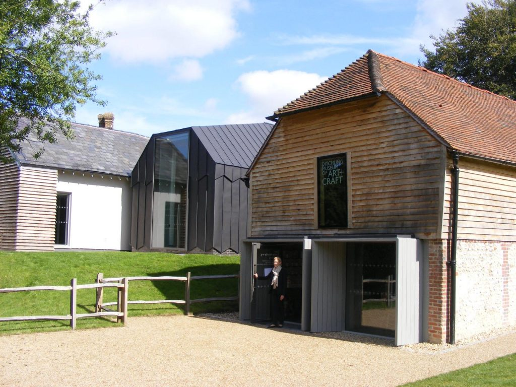a photo of the front entrance of Ditchling Museum - an old converted barn