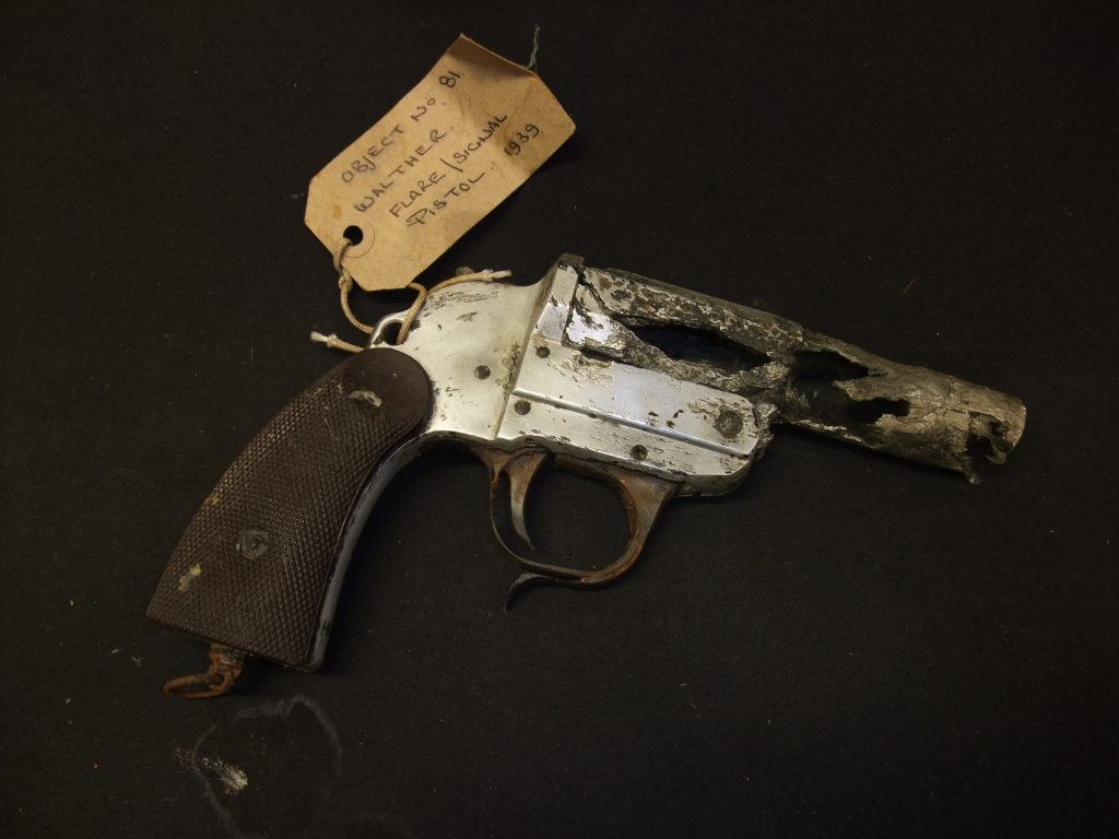 A photo of a flare pistol with corrosion to its chamber