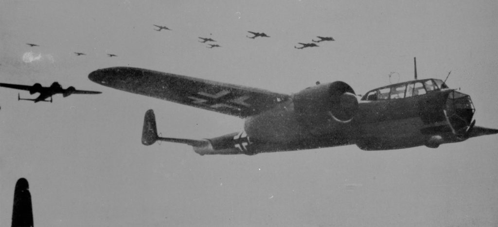 a black and white photo of a Dornier bomber in formation with others