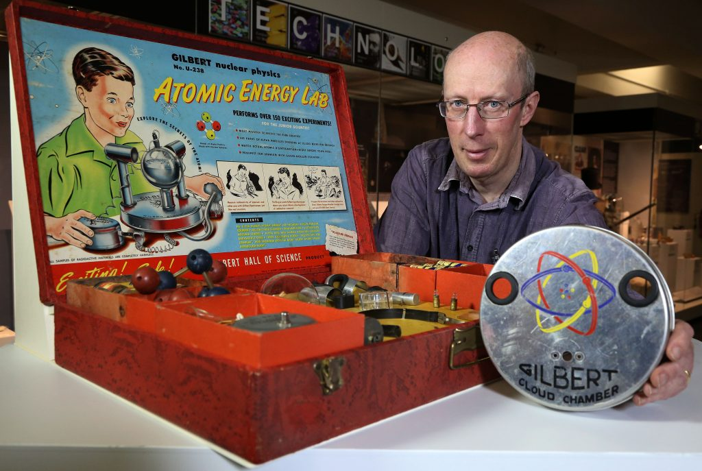 a photo of a man with a science set
