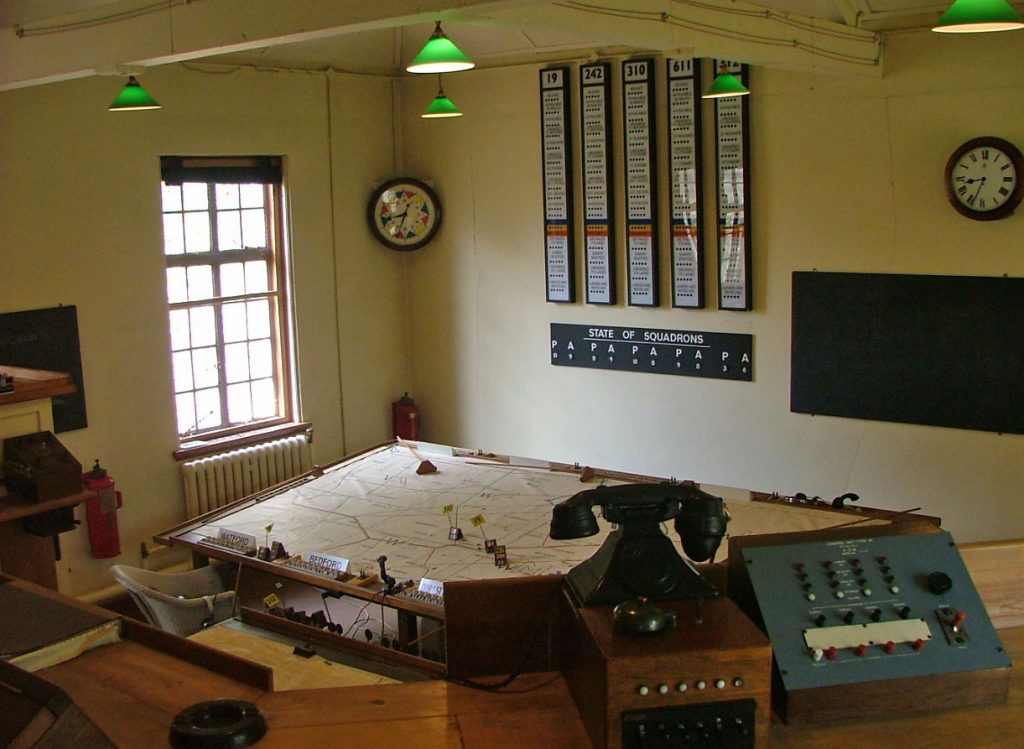 a photo of an ops room with plotting table in the foreground