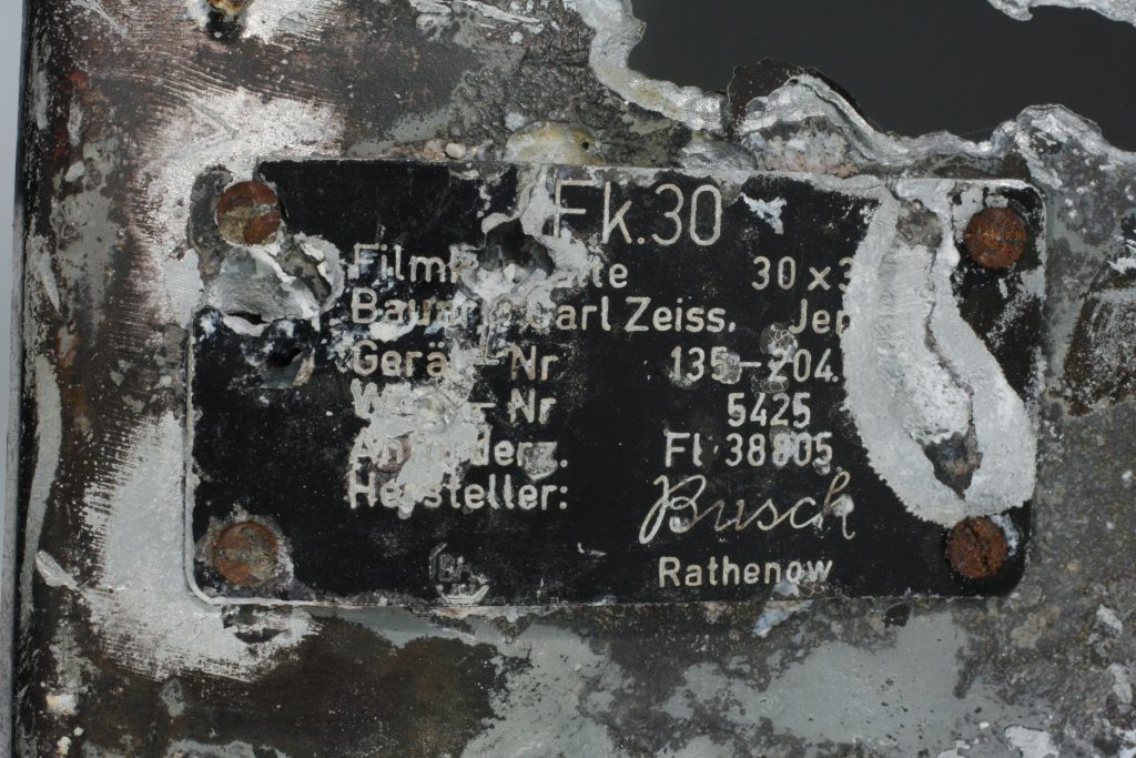 a close up of a balcvk metal plate with German writing and lettering on it
