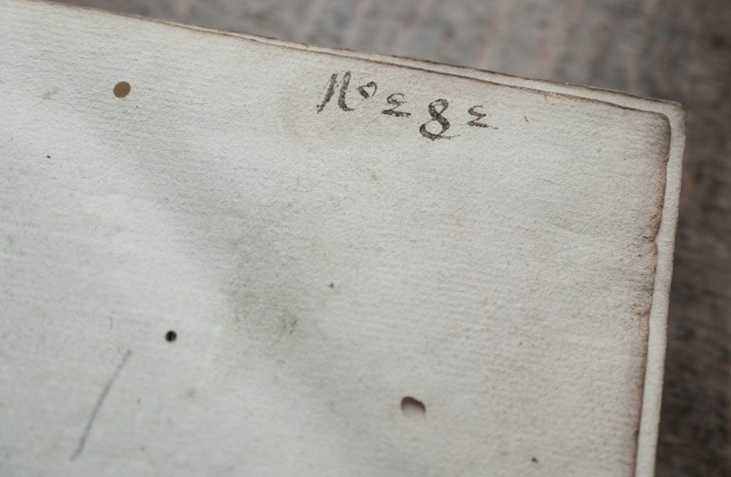 a close up of an annotation in an old book margin