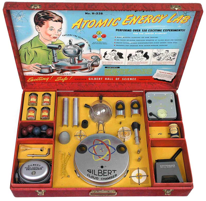a photo of a cased toy called the atomic energy lab