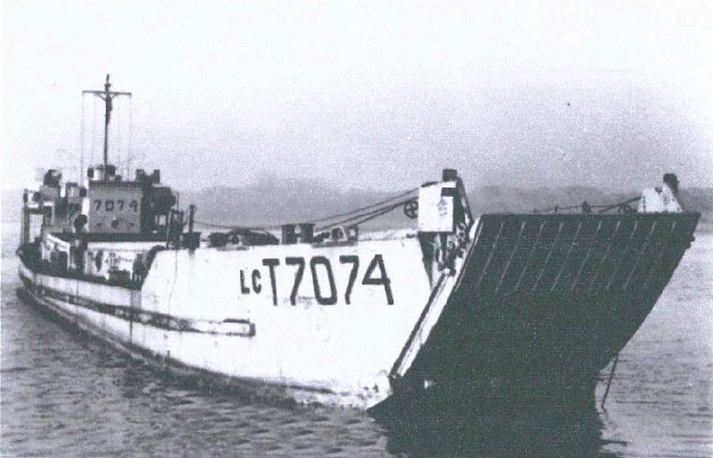 A black and white photo of a large landing craft