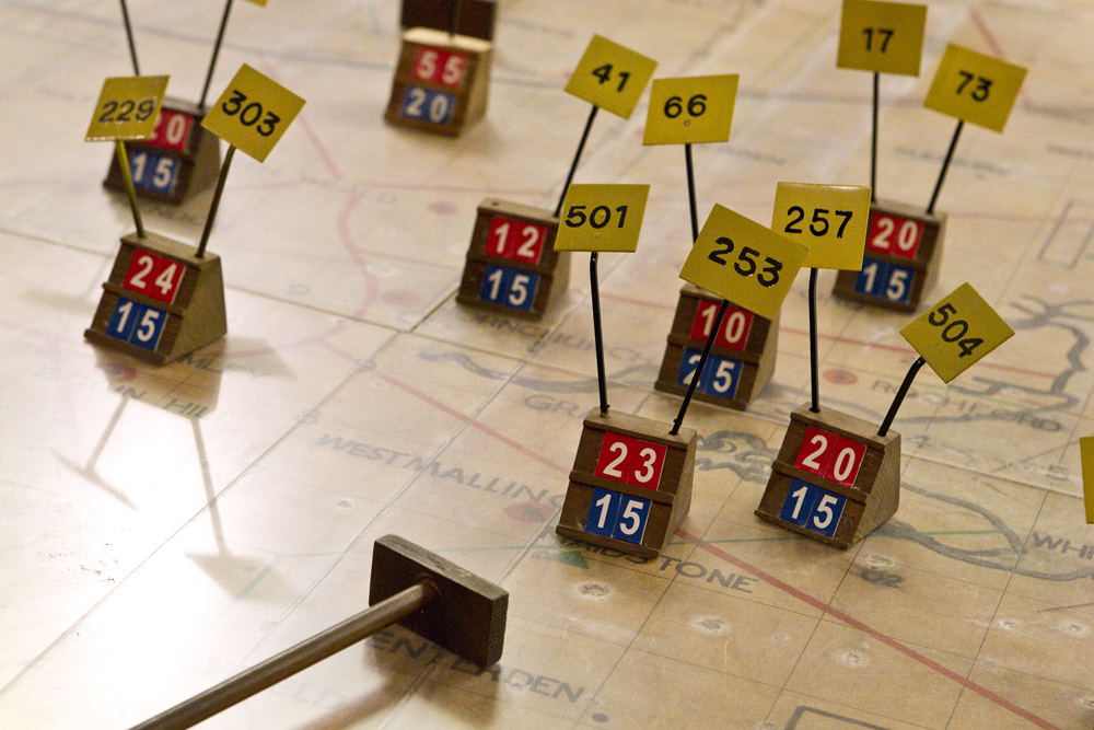 A close up of the battle markers on the map table