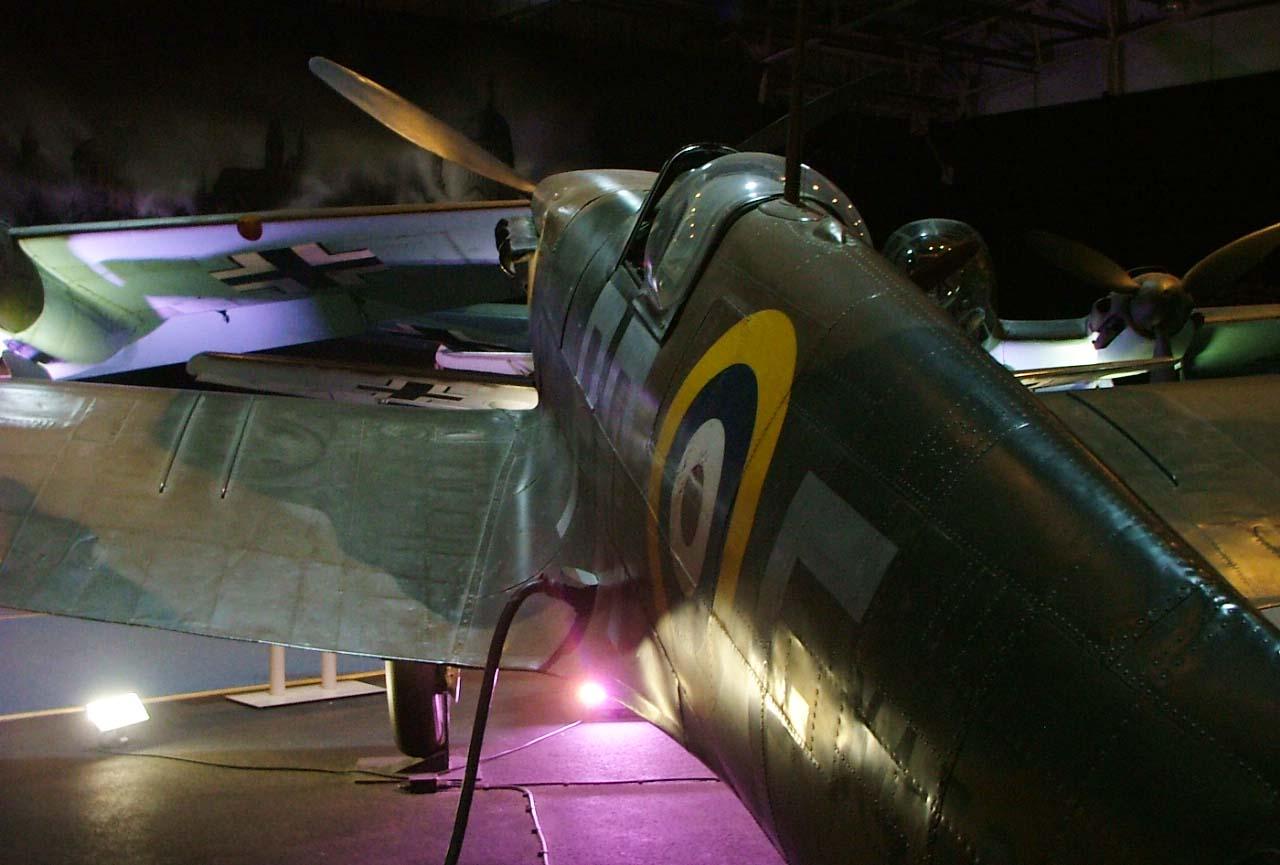 a photo of a Spitfire seen from behind looking across at a Messerschmitt 109