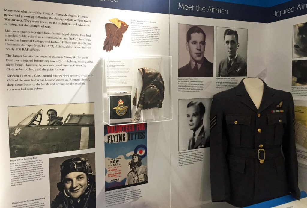 a photo of a gallery display with storyboard, flying helmet and RAF uniform