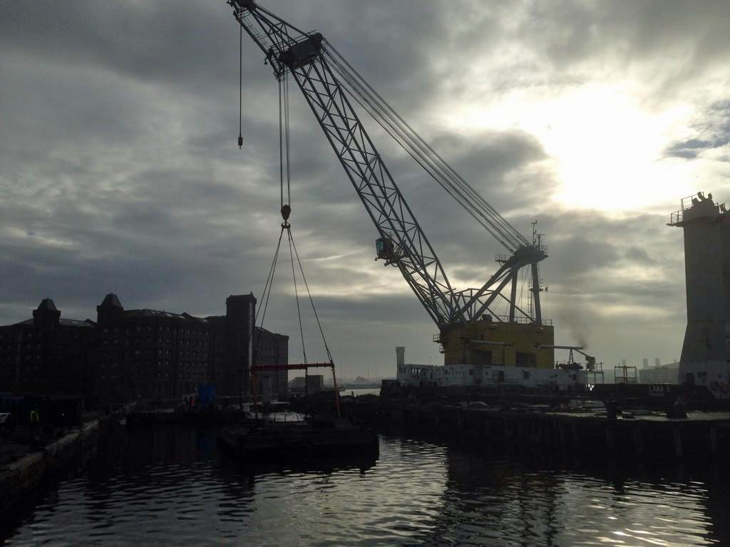 a photo of a dockside crane lifting an object from the water