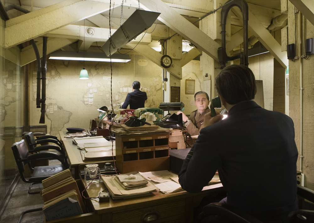 A recreated scene within the Churchill War Rooms, manequins work to map raids
