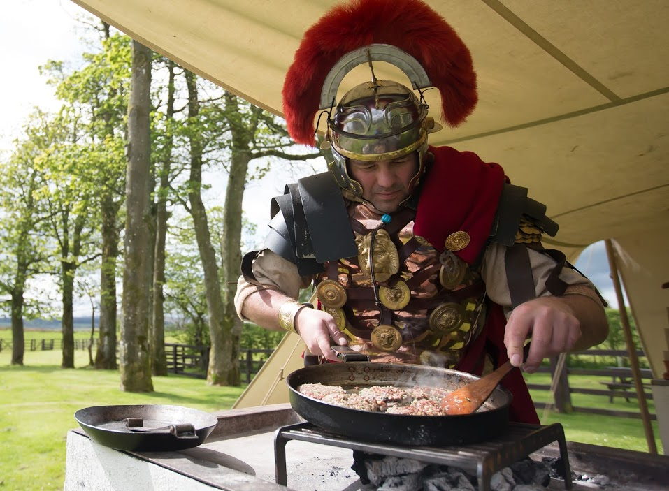 Joe Jackson, dressed as a Roman Centurion, makes a Roman Burger at Birdoswald Roman Fort in Cumbria © Picture by Dave Thompson / Route OnePhotography / English Heritage