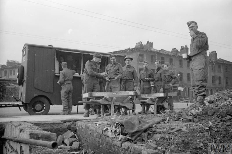 a black and white photo of soldiers at a canteen in London