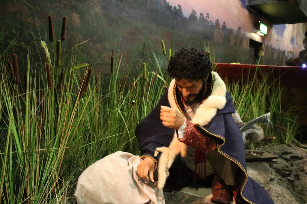 A dummie Arab trader knelt by a riverside