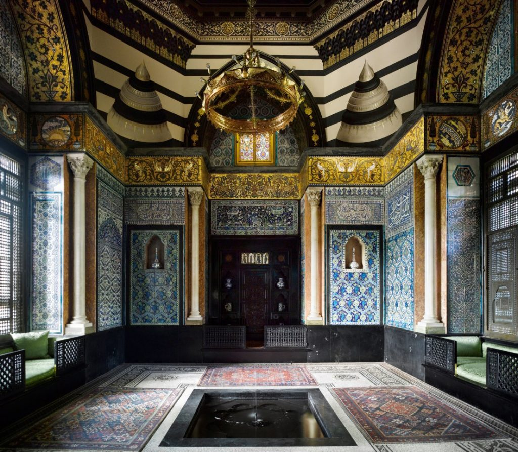 The interior of Leighton House shows Eastern influences with blue ceramic tiles on the walls and a central water feature