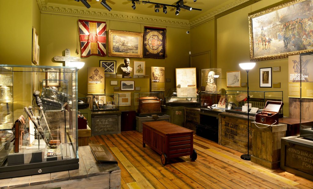 a photo of a gallery with cases containing artefacts