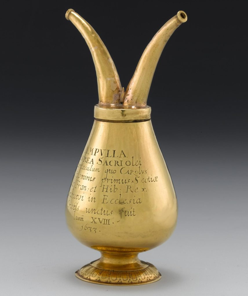 a n engraved golden vessel with two horns protruding from its top