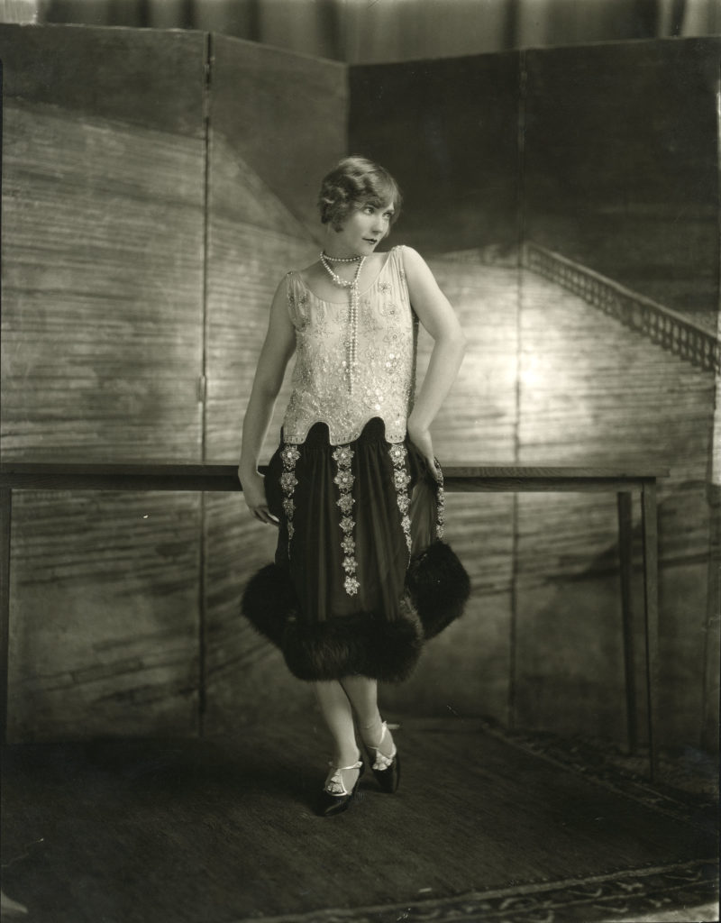 a photo of a woman with a twenties flapper dress and short hair