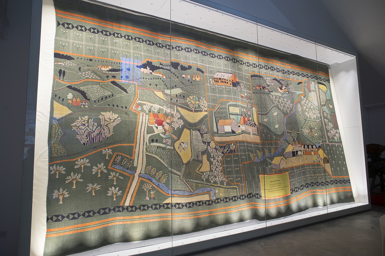 a photo of a wall hanging housed in a large display case