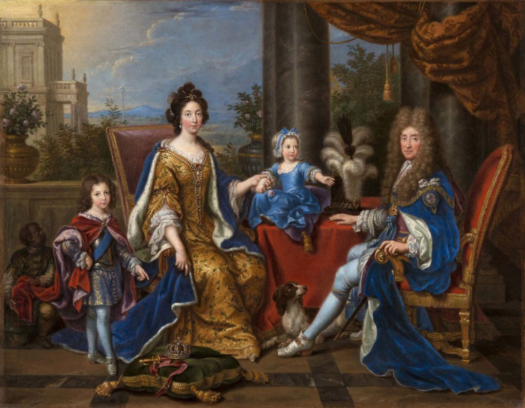 A group portrait of a Royal family in opulent earlry eighteenth century dress