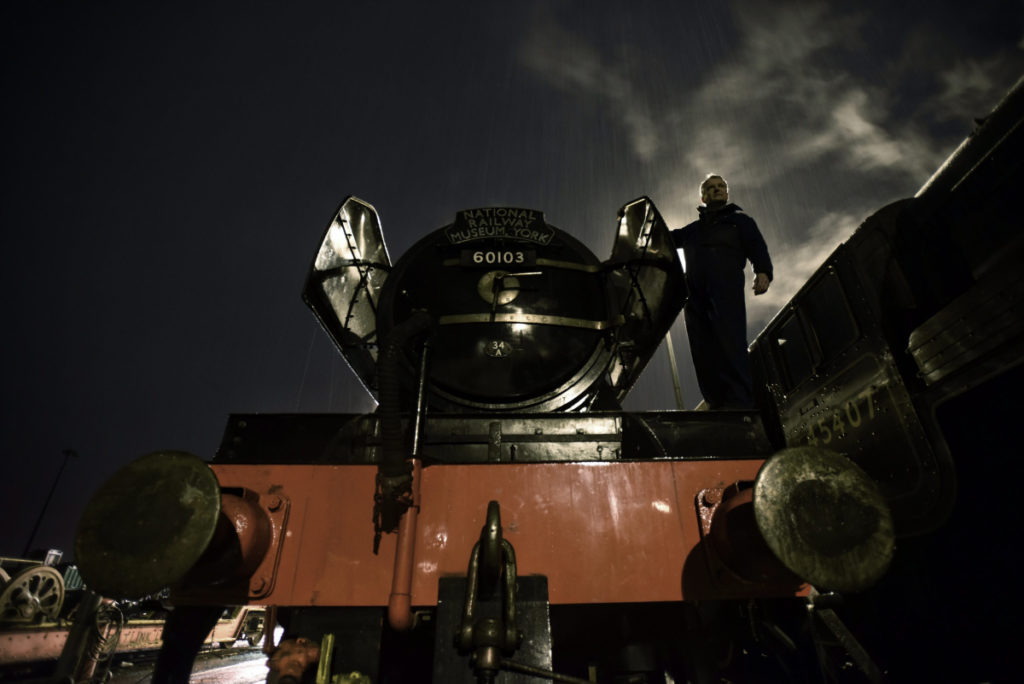a photo of flying scotsman seen from the front in the early morning
