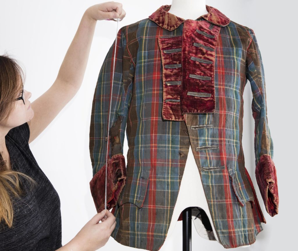 a photo of a tartan short frock coat