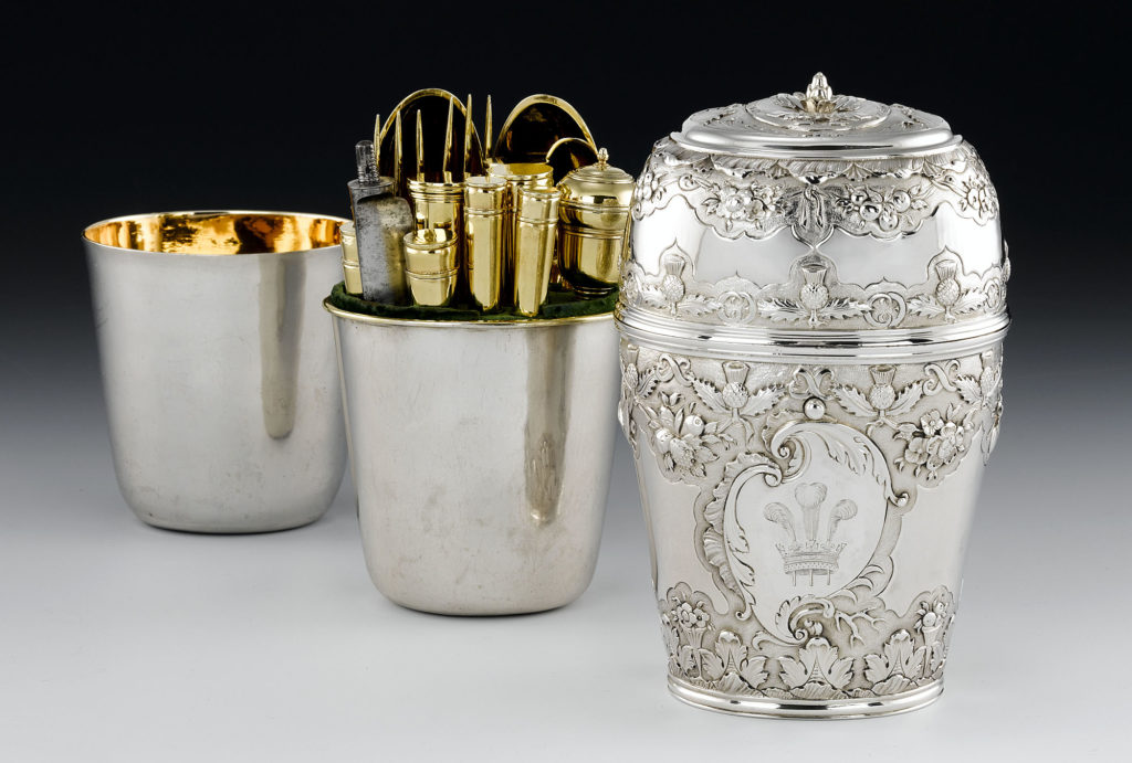 a photo of a canteen engraved with silver