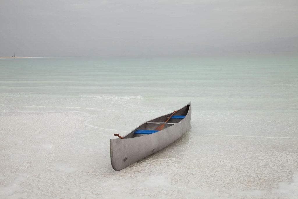 a photo of a canoe on a calm sea