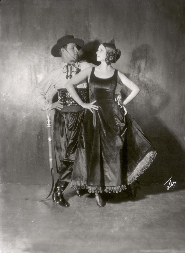 a photo of a couple wearing male and female flamenco outfits