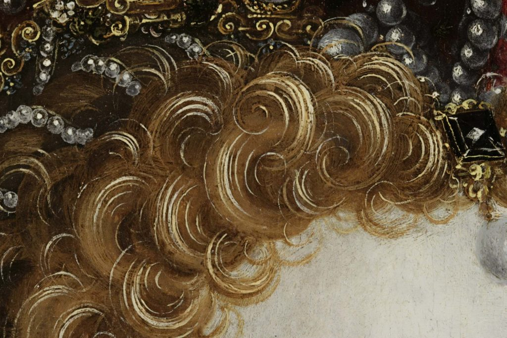 a close up of ginger curls on the head of a painting of Elizabeth I