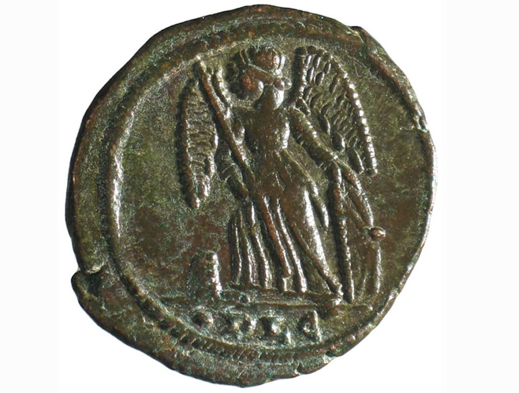 a photo of a coin with a winged figure on it
