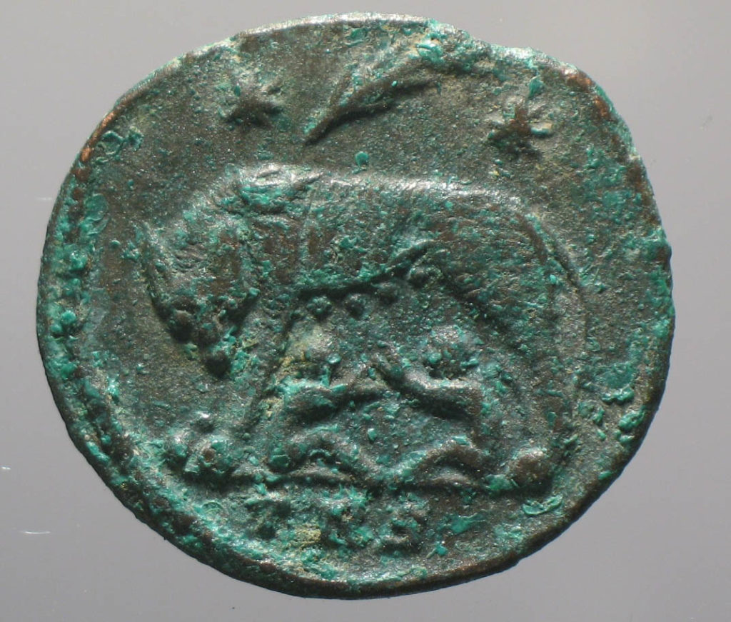 a photo of a coin with a Romulus and Remus motif