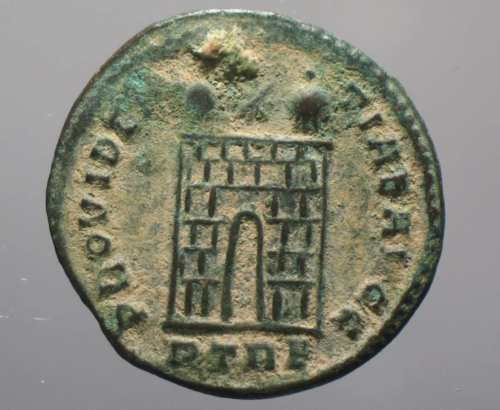 a photo of a small coin with a tower on it