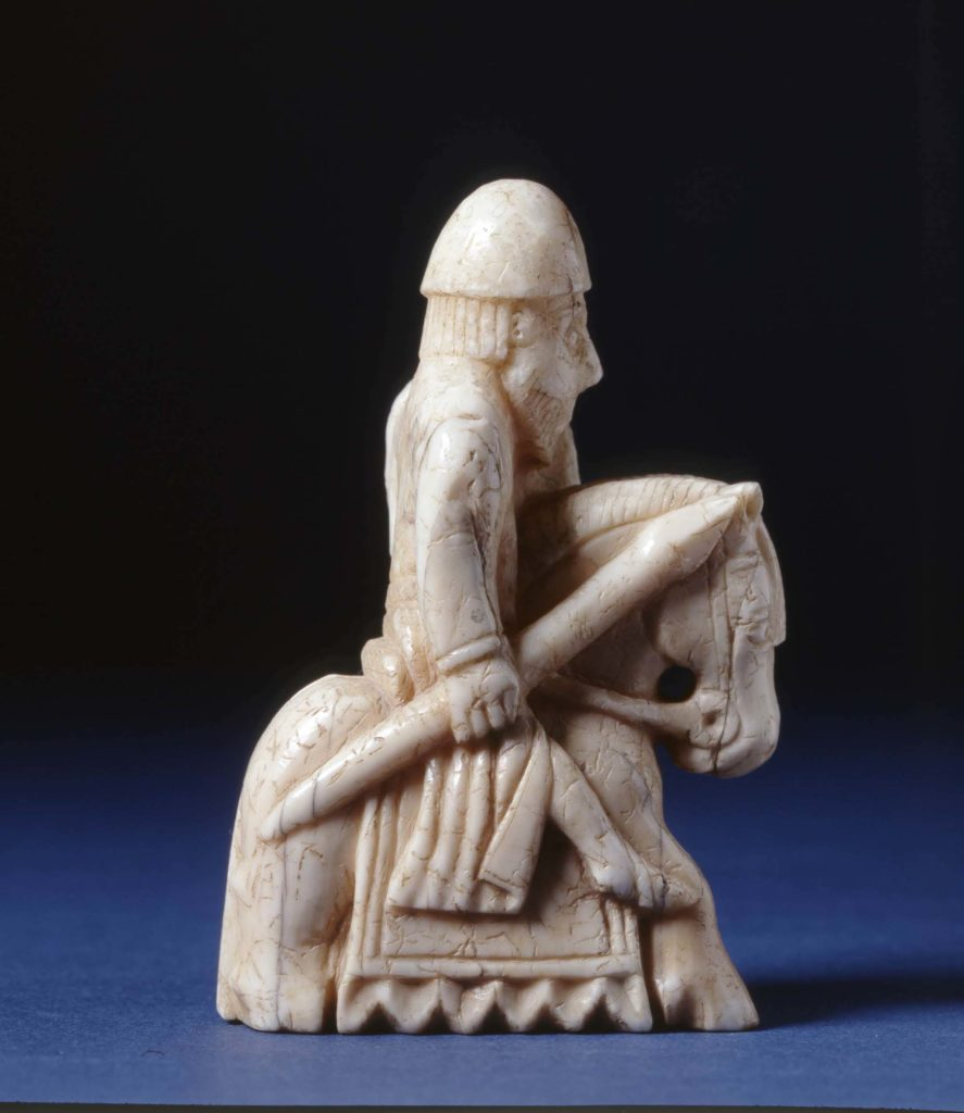 a photo of a stone carved knight in profile