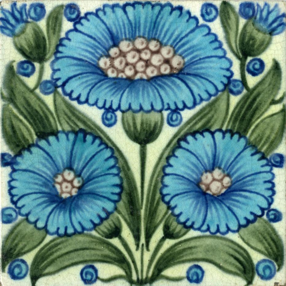 a colourful tile with a symmetrical blue flower design