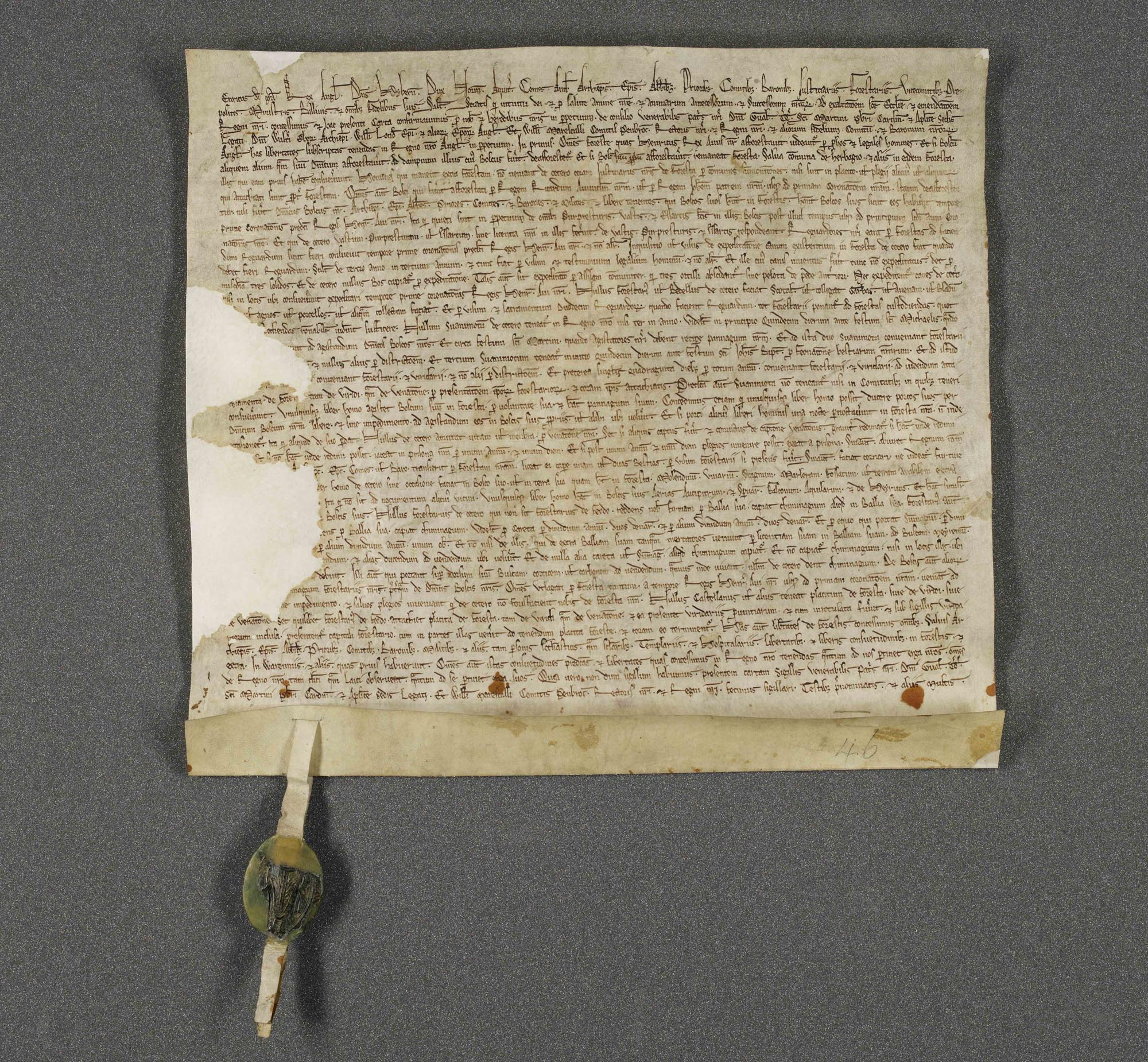 a photo of a parchment letter with medieval seal on it
