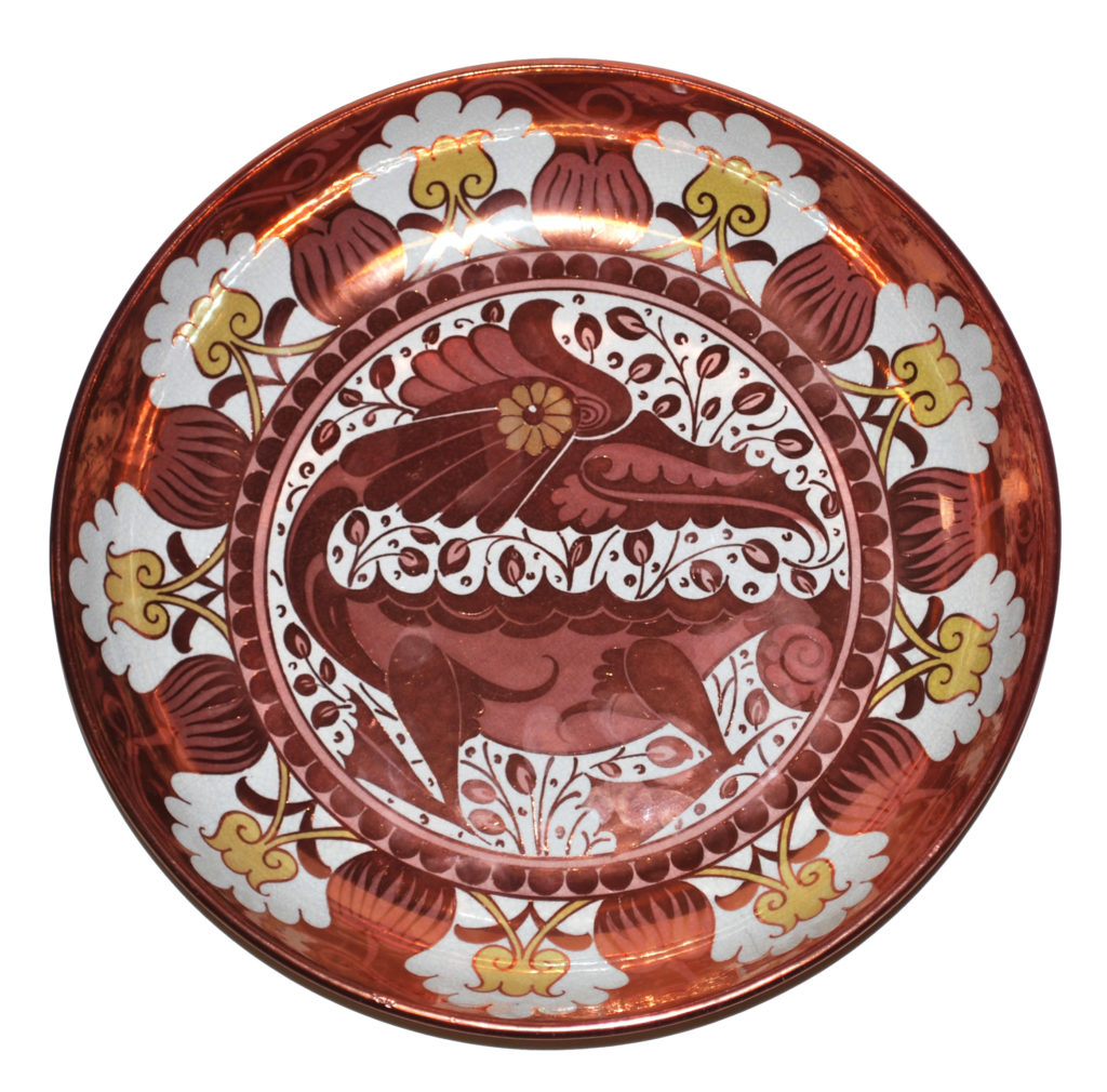 a round plate with sea monster motif