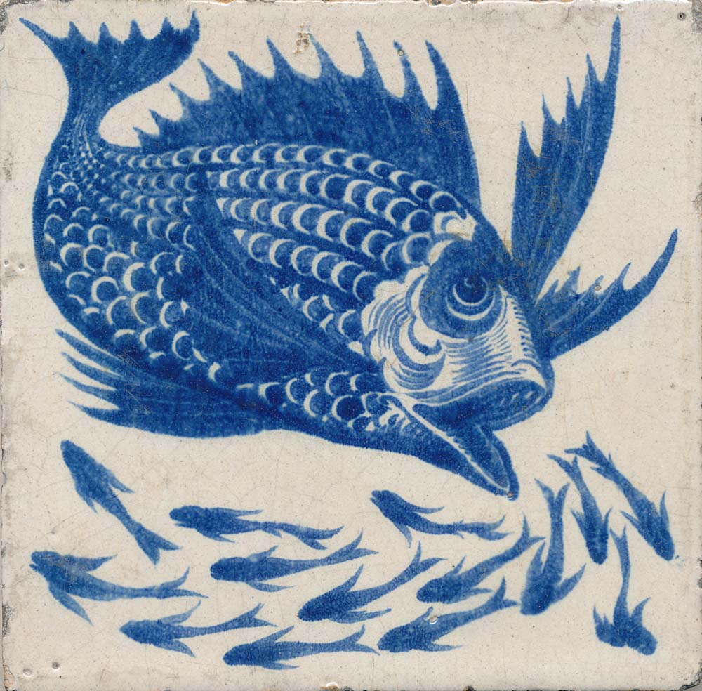 a photo of a fish tile with a blue fish printed onto it