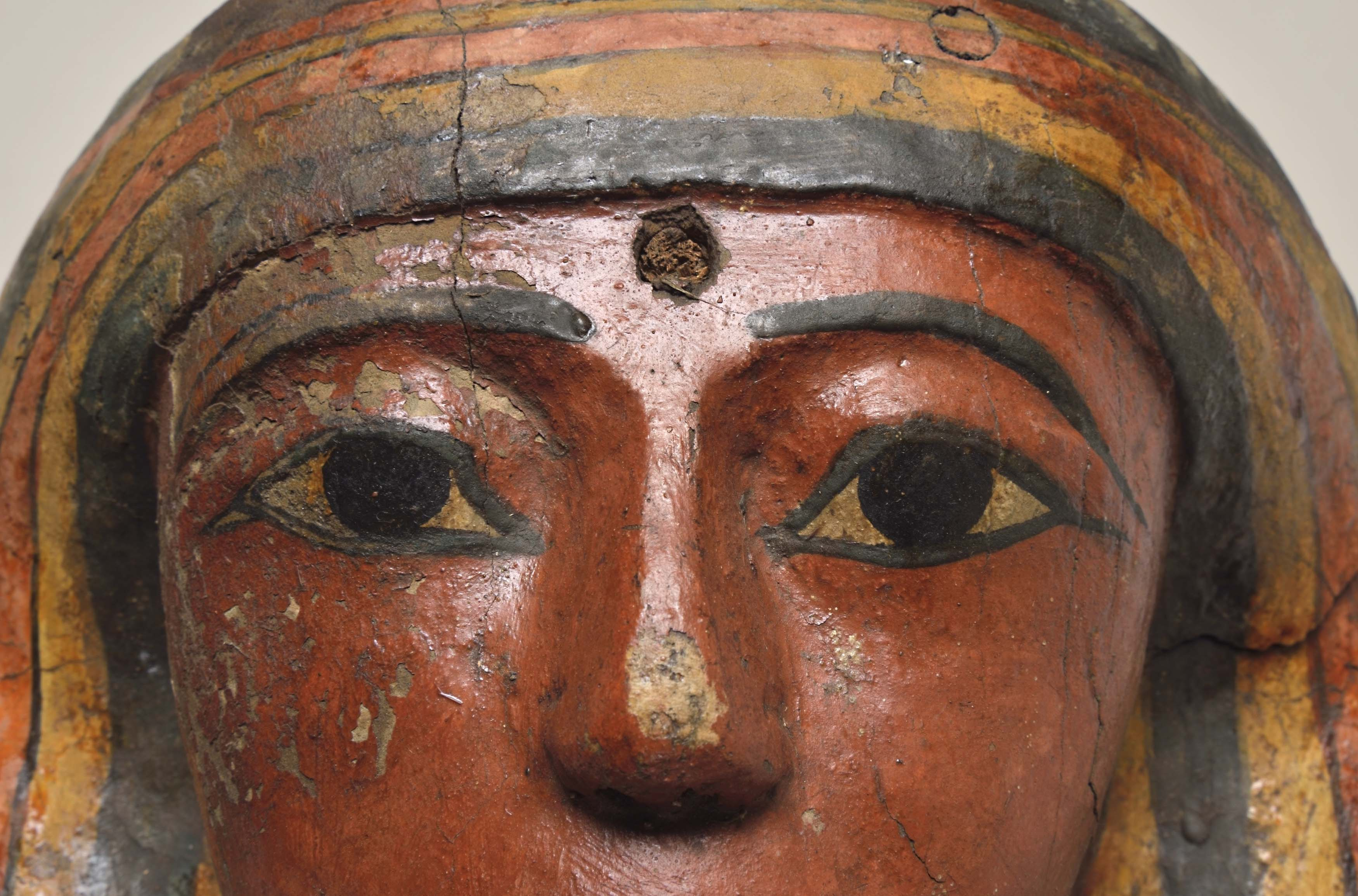 a close up of the eyes in the mask of the coffin of an Egyptian mummy
