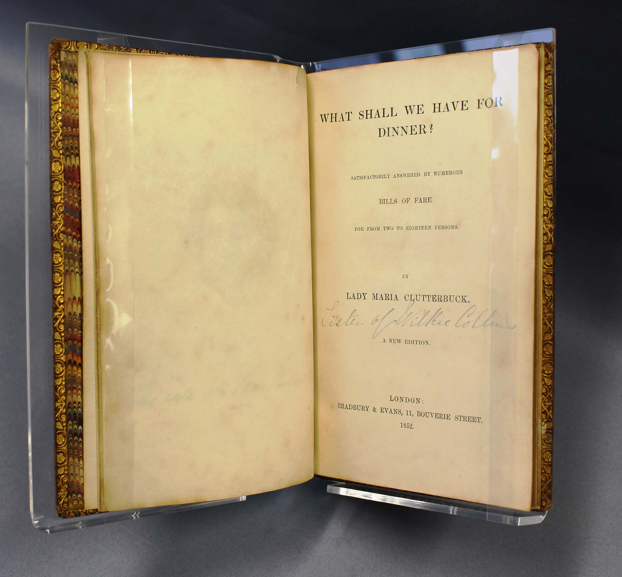 a photo of an open book at the frontispiece page
