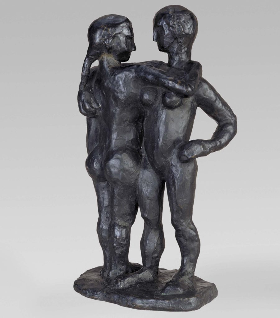 a photo of carved models of two people embracing